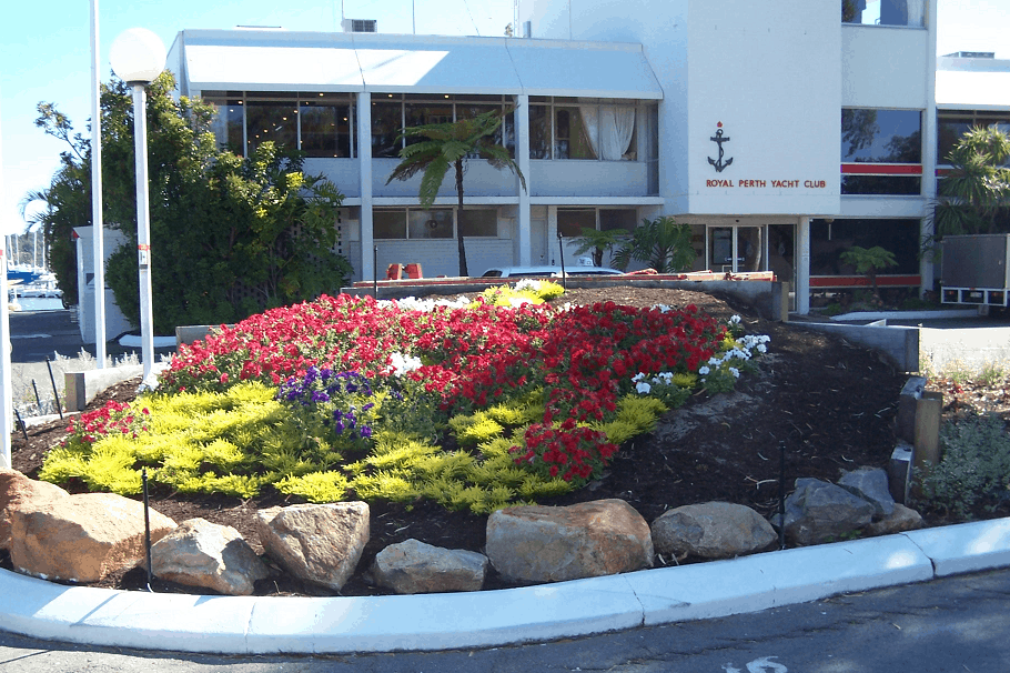 Royal Perth Yacht Club building with flower beds by Landscapes For Life